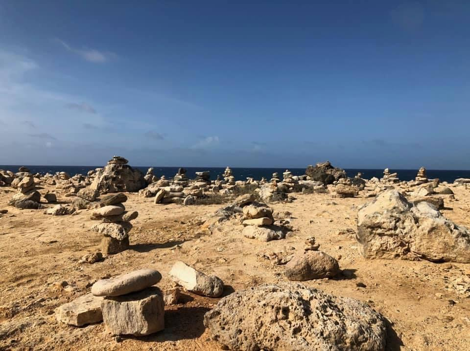 Sand with rows of stacked stones